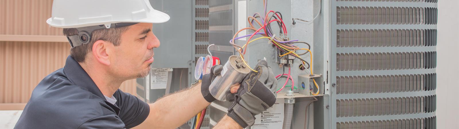 a technician performing commercial AC repair